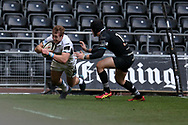 Brandon Thomson of Glasgow Warriors evades a tackle from Sam Davies of the Ospreys to score his teams 6th try. Guinness Pro14 rugby match, Ospreys v Glasgow Warriors Rugby at the Liberty Stadium in Swansea, South Wales on Sunday 26th November 2017. <br /> pic by Andrew Orchard, Andrew Orchard sports photography.