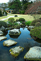 Stepping Stones across a Rock Pond Garden in Hakone - A water source in a Japanese garden should appear to be part of the natural surroundings; this is why one will not find fountains in traditional gardens. Man-made streams are built with curves and irregularities to create a serene and natural appearance