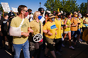 "28 JULY 2020 - DES MOINES, IOWA: Des Moines' ""Wall of Moms"" march in front of Black Lives Matter protesters to the Governor's Mansion in Des Moines. About 150 supporters of Black Lives Matter marched from downtown to Des Moines to the Governor's Mansion. They were demanding that Iowa Governor Kim Reynolds restore the voting rights for felons who have completed their sentence. In June, Reynolds met with representatives of Black Lives Matter and promised to sign an executive order to restore voting rights, but she hasn't said anything more about it in six weeks. Iowa is now the only state in the US that permanently strips felons of their voting rights. That means 60,000 people in Iowa can't vote.    PHOTO BY JACK KURTZ"