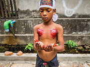 04 NOVEMBER 2014 - YANGON, MYANMAR: A Burmese boy prays after flagellating himself with chains and razors on Ashura in Yangon. The flagellation shows solidarity with Hussein and his family. Mogul Mosque is the principal Shia mosque in Yangon. Ashura commemorates the death of Hussein ibn Ali, the grandson of the Prophet Muhammed, in the 7th century. Hussein ibn Ali is considered by Shia Muslims to be the third imam and the rightful successor of Muhammed. He was killed at the Battle of Karbala in 610 CE on the 10th day of Muharram, the first month of the Islamic calendar. According to Myanmar government statistics, only about 4% of the population is Muslim. Many Muslims have fled Myanmar in recent years because of violence directed against Burmese Muslims by Buddhist nationalists.     PHOTO BY JACK KURTZ