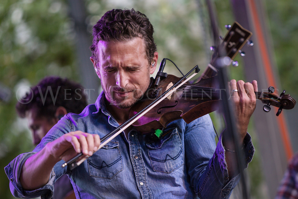 The violinist from Scythian plays the stage on Fayetteville St., during the Streetfest portion of the Wide Open Bluegrass music festival, Sept. 30, 2017. (Photos by - JOHN WEST)