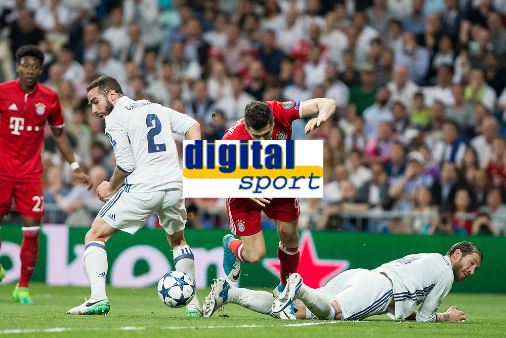 Daniel Carvajal and Sergio Ramos competes for the ball with Robert Lewandowski of FC Bayern Munchen during the match of Champions League between Real Madrid and FC Bayern Munchen at Santiago Bernabeu Stadium  in Madrid, Spain. April 18, 2017. (ALTERPHOTOS)