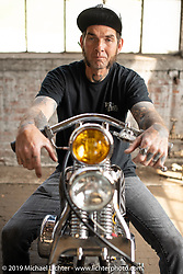 Luke Woolard on his 1976 Ironhead Sportster (built in his Ayden, NC garage) on setup day at the Congregation Show in Charlotte, NC. USA. Friday April 13, 2018. Photography ©2018 Michael Lichter.