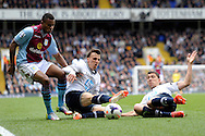 Aston Villa's Leandro Bacuna (r) and Tottenham Hotspur's Vlad Chiriches and Tottenham Hotspur's Milos Veljkovic tyring to take the ball . Barclays premier league match ,Tottenham Hotspur v Aston Villa at White Hart Lane in Tottenham, London  on Sunday 11th May 2014.<br /> pic by John Patrick Fletcher, Andrew Orchard sports photography.