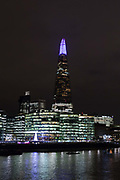 The top spire of the Shard is illuminated in blue, on December 4th 2017 in London, United Kingdom, on the first evening of the Shards festive Christmas light show. Every evening, counting down to the start of 2018, the Shard will illuminate the London skyline from dusk till dawn, with Western Europe's highest light show each evening during December.