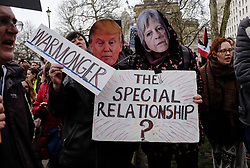 April 13, 2018 - London, England, United Kingdom - Two people wear masks baring the faces of Donald Trump and Theresa May during the protest in London. Hundreds of people gather outside downing street to protest against possible military action against the Syrian goverment. (Credit Image: © Jay Shaw Baker/NurPhoto via ZUMA Press)