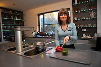 housewife cooking in modern kitchen, preparing vegetables for family