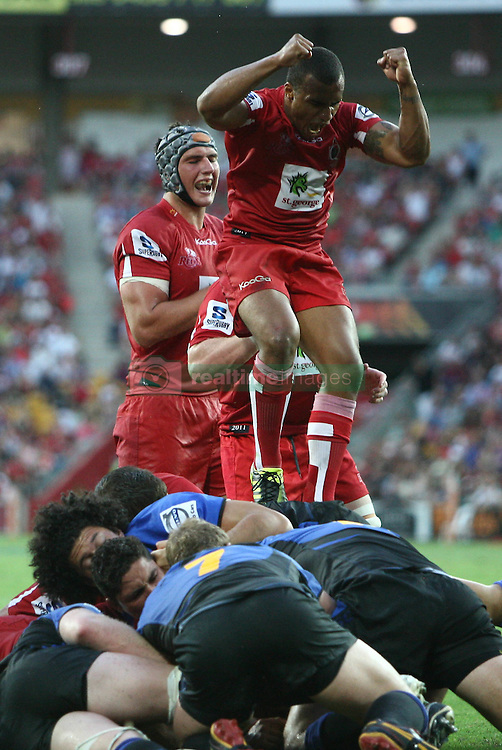 Will Genia celebrates after Reds James Hansen score their second try - Action during the Super 15 match between the Queensland Reds and the Western Force. Final score Force (20) - Reds (21)...Played at Lang Park, Brisbane (20 February 2011)...Photo: SMP IMAGES (Warren Keir)/SPORTZPICS