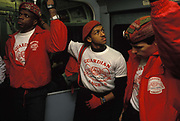 Volunteer member of the Guardian Angels patrol the London underground in central London, an experiment in anti-crime in late-80s London, on 27th January 1989, in London, England. The Angels are under the supervision of the organisations creator Curtis Sliwa, who started the band of youths to help make New York a safer place, - and in Londons case in an era before CCTV made travel less secure. The Guardian Angels is a non-profit international volunteer organisation of unarmed citizen crime patrollers. The Guardian Angels organisation was founded February 13, 1979 with chapters in 15 countries and 144 cities around the world. Sliwa originally created the organization to combat widespread violence and crime on the New York City Subways.