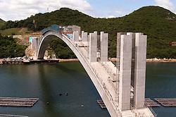 Construction of Kashirajima Bridge with concrete arch built using Melan technique in Japan