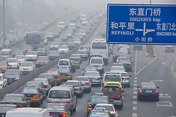 Traffic jam and pollution on main highway in Beijing