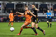 Luton Town Defender Jack Stacey (7) and AFC Wimbledon Midfielder Anthony Hartigan (8) battle for the ball during the EFL Sky Bet League 1 match between Luton Town and AFC Wimbledon at Kenilworth Road, Luton, England on 23 April 2019.