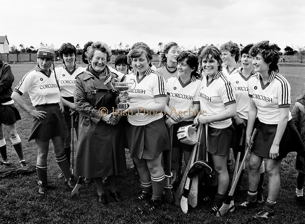 The National League camogie final was contested between Cork and Dublin at Lorcan O'Toole Park, Kimmage, Dublin. Here Muireann McCarthy, captain of the victorious Cork team, receives the cup from Mrs Mary Lynch, President of the Camogie Association.<br />