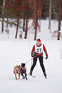 Photo Randy Vanderveen.Grande Prairie , Alberta.13-01-05.Doris Gordon urges her dogs through the race course as she takes part in the skijor event ? dogs pull the musher around the course on skis as opposed to a sled. The Grande Prairie Sled Dog Derby ran two days of races at Evergreen Park this past weekend, Jan. 5 and 6.