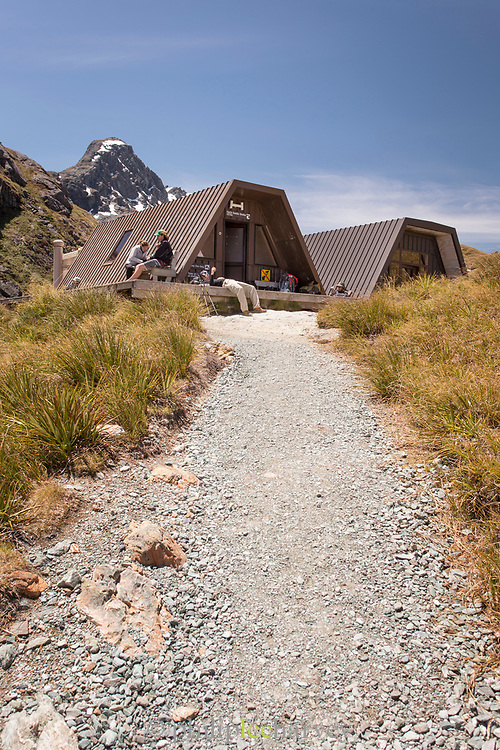 Hikers resting at the Harris Saddle Shelter, Routeburn Track, South Island, New Zealand