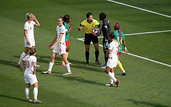Match referee Qin Liang (fourth right) awards a free-kick to England in the penalty area after a back pass by Cameroon's Augustine Ejangue (fourth left) during the FIFA Women's World Cup, round of Sixteen match at State du Hainaut, Valenciennes.