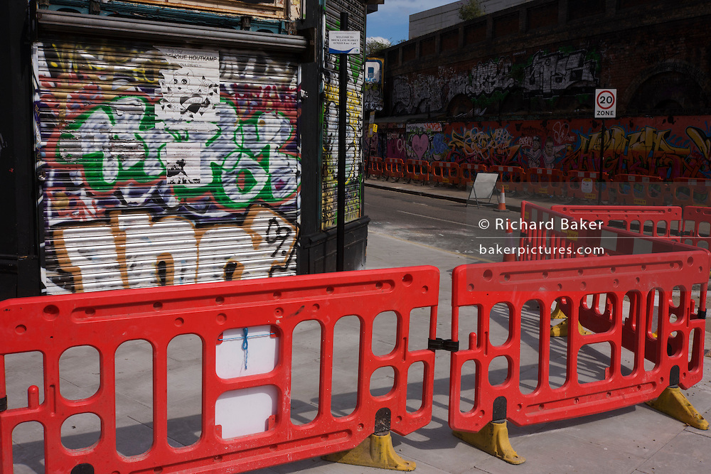 Roadworks and graffiti on a crossing in East London.