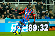 Cheikhou Kouyate (#8) of Crystal Palace on the ball during the Premier League match between Newcastle United and Crystal Palace at St. James's Park, Newcastle, England on 21 December 2019.