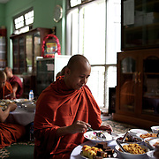 "May 14, 2013 - Mandalay, Myanmar: Ashin Wirathu, the buddhist monk leader of Burma's anti-Muslim movement 969 group, takes the traditional midday meal offered by regular citizens at Mosayein Monastery in central Mandalay. Wirathu, who was jailed in 2003 for inciting religious hatred, refers to himself as ""the Burmese Bin Laden"". (Paulo Nunes dos Santos/Polaris)"