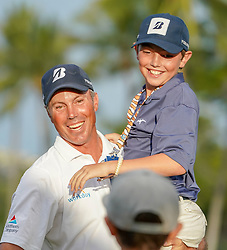 January 13, 2019 - Honolulu, HI, U.S. - HONOLULU, HI - JANUARY 13: Matt Kuchar (l) hold up his son Cameron after winning the Sony Open at the Waialae Country Club in Honolulu, HI. (Photo by Darryl Oumi/Icon Sportswire) (Credit Image: © Darryl Oumi/Icon SMI via ZUMA Press)