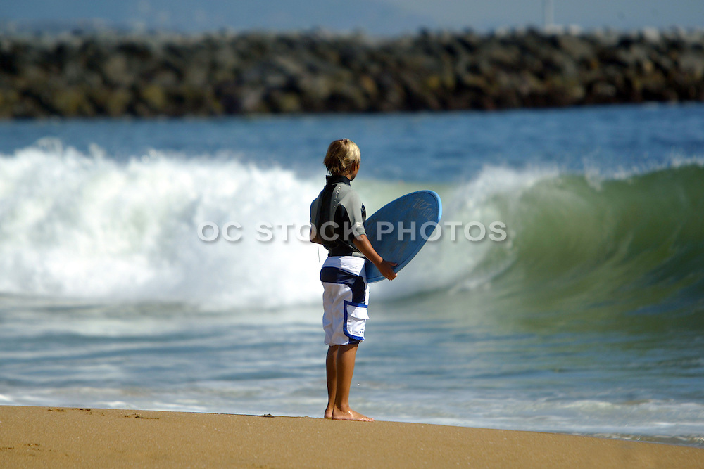 Young Skim Boarder Watching Waves