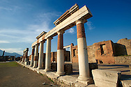 """The Roman Columns of The Building of Eumachia, Pompeii. The inscription on lintel above the columns is to Concordia Augusta, wife of Emperor Augustus, from the priestess Eumachia the patron of the """"fullones"""", an artisan association of dyers. The building was a prototype of medieval hostels were travelling merchant rented accommodation. .<br /> <br /> If you prefer to buy from our ALAMY PHOTO LIBRARY  Collection visit : https://www.alamy.com/portfolio/paul-williams-funkystock/pompeii.html<br /> Visit our CLASSICAL WORLD HISTORIC SITES PHOTO COLLECTIONS for more photos to buy as buy as wall art prints https://funkystock.photoshelter.com/gallery-collection/Classical-Era-Historic-Sites-Archaeological-Sites-Pictures-Images/C0000g4bSGiDL9rw"""