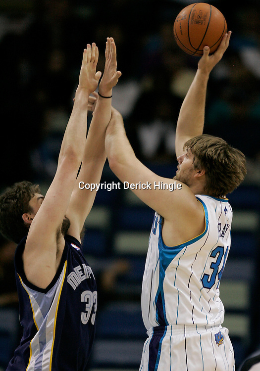 Mar 03, 2010; New Orleans, LA, USA; New Orleans Hornets center Aaron Gray (34) shoots over Memphis Grizzlies center Marc Gasol (33) during the first half at the New Orleans Arena. Mandatory Credit: Derick E. Hingle-US PRESSWIRE
