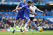 Ross Barkley of Everton being challenged by Diego Costa of Chelsea. Barclays Premier league match, Chelsea v Everton at Stamford Bridge in London on Saturday 16th January 2016.<br /> pic by John Patrick Fletcher, Andrew Orchard sports photography.