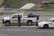 April 2, 2014 - Fort Hood, TX, USA - <br /> <br /> Gunman Kills 3, Wounds 16 at Fort Hood Army Base<br /> <br /> A Bell County Sheriff's Department official stands near his vehicle as cars are checked at the Bernie Beck Main Gate at Fort Hood, Texas, on Wednesday, April 2, 2014.<br /> ©Exclusivepix