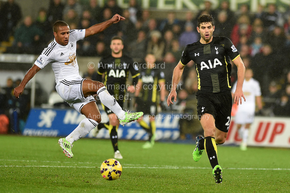 Wayne Routledge of Swansea city (l) hits a shot wide of goal. Barclays Premier League match, Swansea city v Tottenham Hotspur at the Liberty Stadium in Swansea, South Wales on Sunday 14th December 2014<br /> pic by Andrew Orchard, Andrew Orchard sports photography.