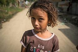A girl in Chamelecón, San Pedro Sula, Honduras.