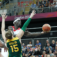 31 July 2012: Great Britain Pops Mensah-Bonsu goes for the layup against Brazil Tiago Splitter during 67-62 Team Brazil victory over Team Great Britain, during the men's basketball preliminary, at the Basketball Arena, in London, Great Britain.