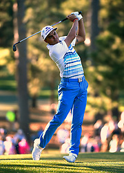 Rickie Fowler follows through on his second shot from the 17th fairway during the third round of the Masters Tournament at Augusta National Golf Club in Augusta, Ga., on Saturday, April 8, 2017. (Photo by Jeff Siner/Charlotte Observer/TNS) *** Please Use Credit from Credit Field ***