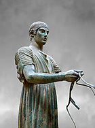 Severe Style Ancient Greek bronze sculpture of a charioteer, 480-460 BC, Delphi National Archaeological Museum.   Against grey.<br /> <br /> The Charioteer is a rare example of Severe Style bronze statue that only servived ancient looters  because it was buried by an earthquake. Plain and austere it mirrors the preveiling aestheics expected from ancient greek atheletes. The statue was probably sculpted following the teachings of Pythagoras of Samos due to its exact symetrical proportions