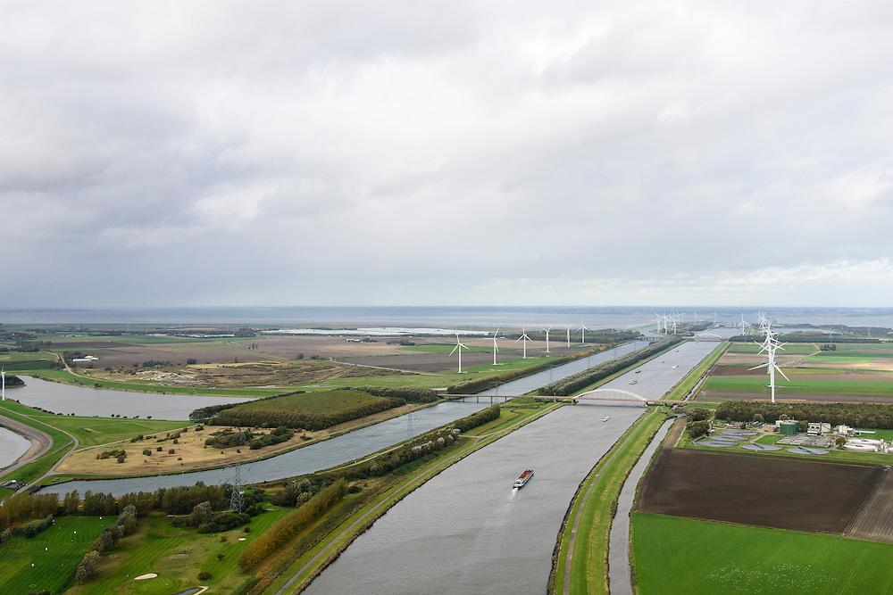 Nederland, Zeeland, Kreekrak, 23-10-2013; Schelde-Rijnverbinding is een vaarroute voor de binnenvaart voor België, Nederland en Duitsland. Windmolens langs de kanalen. Schepen varen langs. Rioolwaterzuiveringsinstallatie (RWZI) Bath (r)<br /> The Schelde-Rhine connection is a route for inland navigation for Belgium, Netherlands and Germany. Windmills along the canals. Ships sail along.<br /> luchtfoto (toeslag op standaard tarieven);<br /> aerial photo (additional fee required);<br /> copyright foto/photo Siebe Swart.