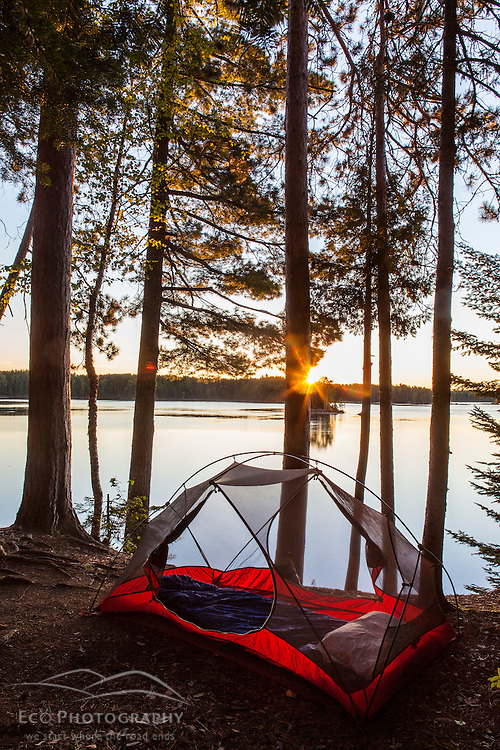 A tent at sunrise on Flagstaff Lake in Eustis, Maine.