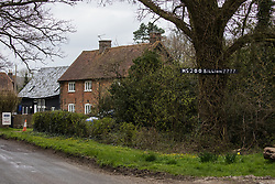 A sign questioning whether costs for the HS2 high-speed rail link have risen to £200bn is pictured outside a house close to Leather Lane in the Chilterns AONB on 9th April 2021 in Great Missenden, United Kingdom. Following pressure from local residents, Buckinghamshire Council and the Chilterns Conservation Board, it appears that HS2 contractors have altered their plans in such a way as to preserve some of the hundred-year-old oak trees lining Leather Lane.