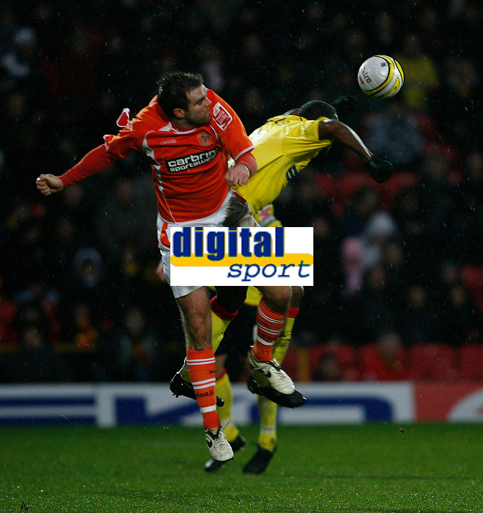 Photo: Richard Lane/Richard Lane Photography. Watford v Blackpool. Coca Cola Championship. 01/11/2008. Ben Burgess (L) and Lloyd Doyley(R) in the air