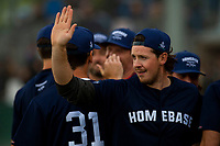 KELOWNA, CANADA - JUNE 28: NHL Nashville Predator Ryan Johansen high fives teammates at the end of the inning during the opening charity game of the Home Base Slo-Pitch Tournament fundraiser for the Kelowna General Hospital Foundation JoeAnna's House on June 28, 2019 at Elk's Stadium in Kelowna, British Columbia, Canada.  (Photo by Marissa Baecker/Shoot the Breeze)