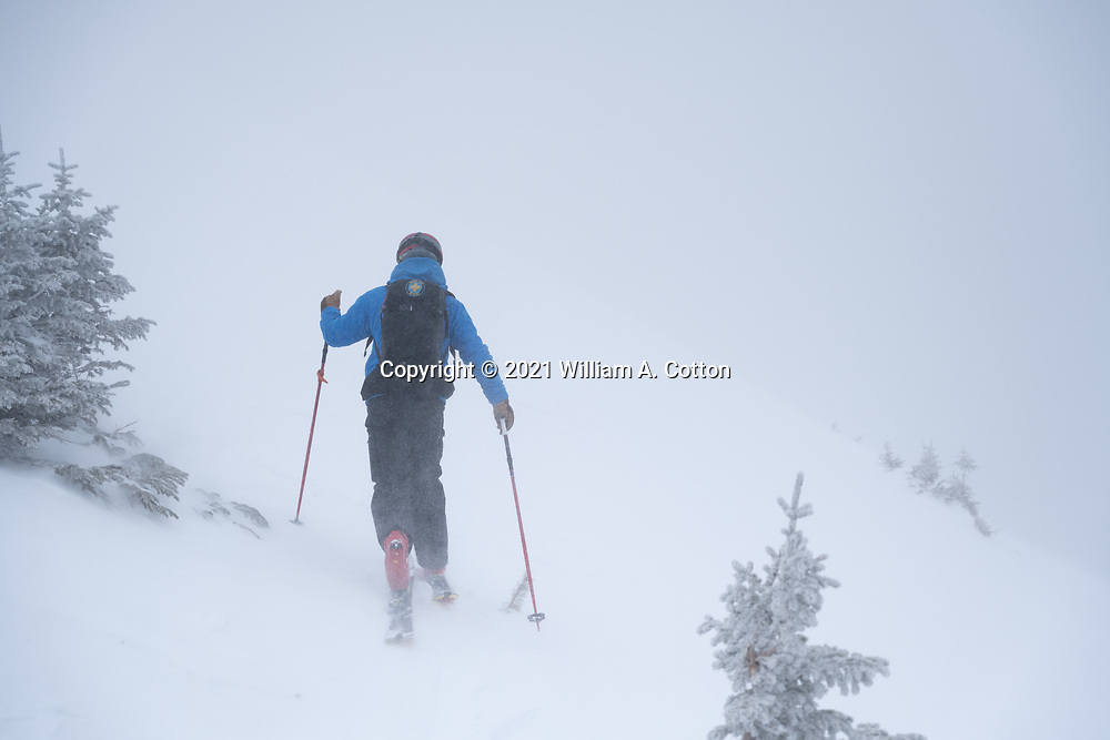 Diamond Peaks Ski Patrol director Owen Richard climbs to the ridgetop near Montgomery Pass, Feb. 6, 2021.