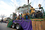 The Tradewinds float throws beads to fans on Davis Street at the fifth-annual Oak Cliff Mardi Gras Parade on Sunday, February 10, 2013 in Dallas, Texas. (Cooper Neill/The Dallas Morning News)