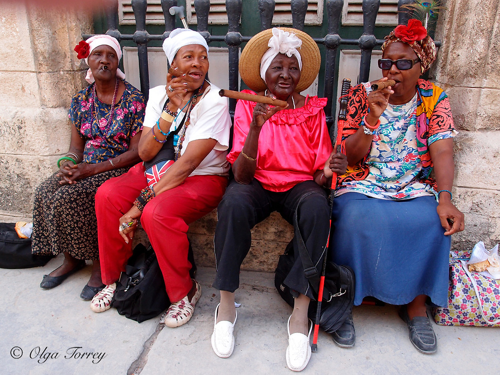 Women smoking cigars in Havana, Cuba.