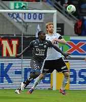 Fotball Tippeligaen Rosenborg - Sandnes Ulf<br /> 28 april 2013<br /> Lerkendal Stadion, Trondheim<br /> <br /> Tosaint Ricketts, Sandnes Ulf (V) og Per Verner Rønning, Rosenborg (H), i duell<br /> <br /> <br /> Foto : Arve Johnsen, Digitalsport