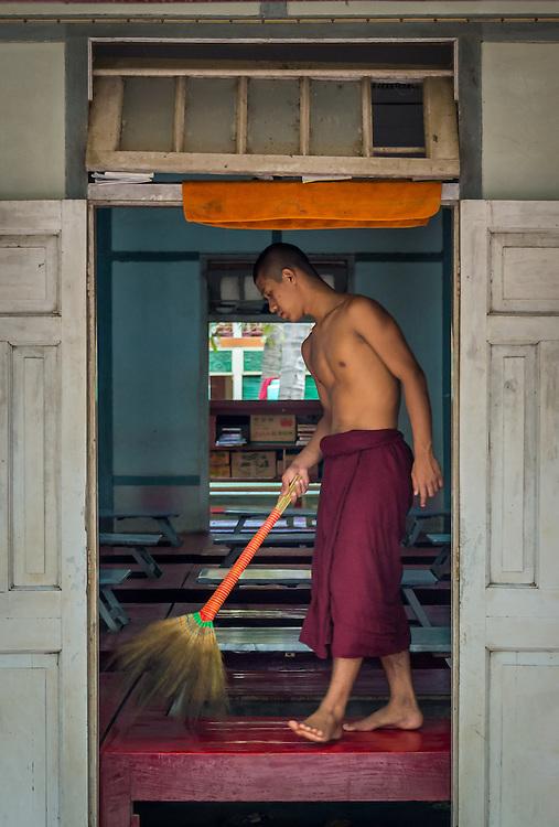 MANDALAY, MYANMAR - CIRCA DECEMBER 2013: Monk cleaning lunch quarters in the Mahar Gandar Yone monastery in Amarpura
