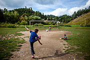 "Children are playing soccer at the Roma part of the district ""Podsadek"". The town of Stara Lubovna has a population of 16350, of whom 2 060 (13%) are of Roma origin. The majority of Roma live in the Podsadek district, where 980 (74%) out of 1330 inhabitants are Roma."