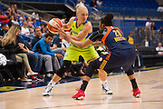 Erin Phillips of the Dallas Wings brings the ball up court against the Connecticut Sun during a WNBA preseason game in Arlington, Texas on May 8, 2016.  (Cooper Neill for The New York Times)