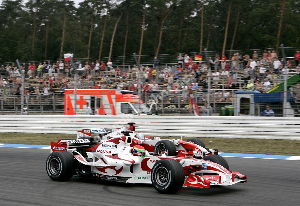 Sakon Yamamoto (Super Aguri-Honda) overtaking Jarno Trulli (Toyota) during Friday's practice for the 2006 German Grand Prix at Hockenheim. Photo: Grand Prix Photo