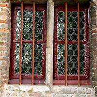 Europe, Belgium, Brugges. Glass bottle window.