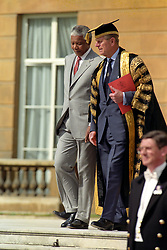 South African President Nelson Mandela and the Duke of Edinburgh at Buckingham Palace, where the President was presented with Honorary Degree's fro eight universities on the second day of his State Visit.