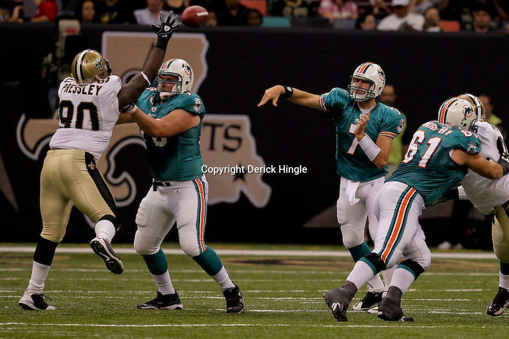 2009 September 03: Miami Dolphins quarterback Chad Henne (7) throws pass New Orleans Saints defensive tackle DeMario Pressley (90) during a preseason game between the Miami Dolphins and the New Orleans Saints at the Louisiana Superdome in New Orleans, Louisiana.